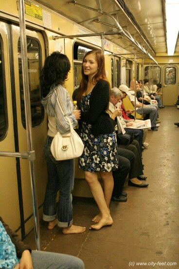 Barefoot on a subway train.