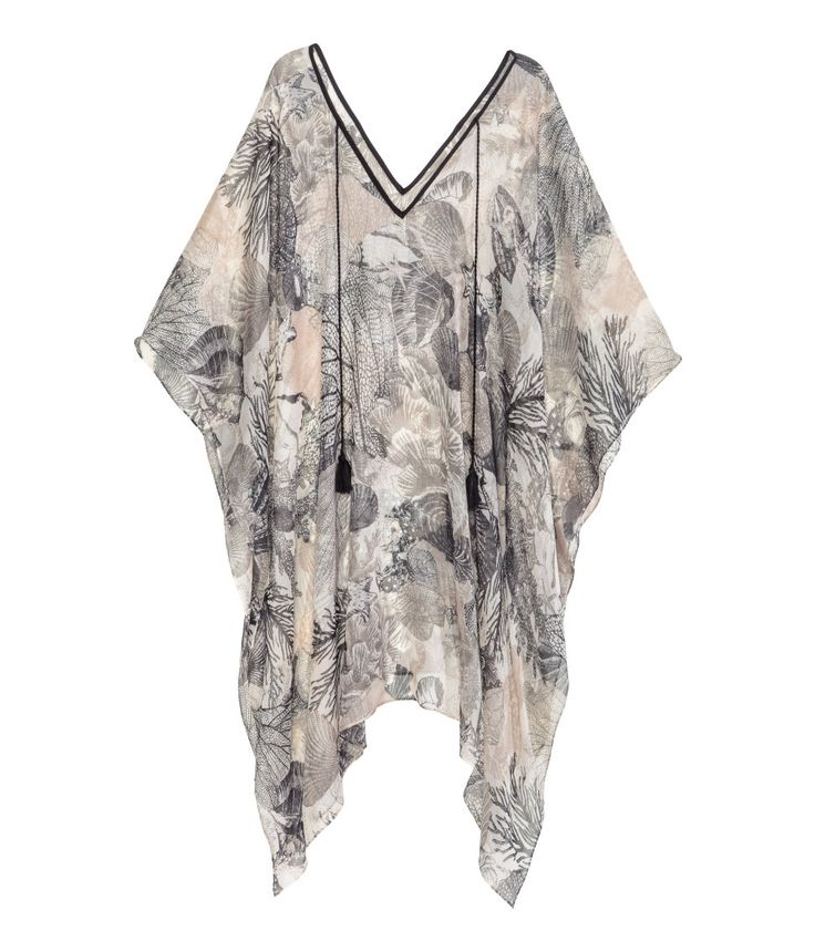 Poncho in airy woven fabric | Warm in H&M