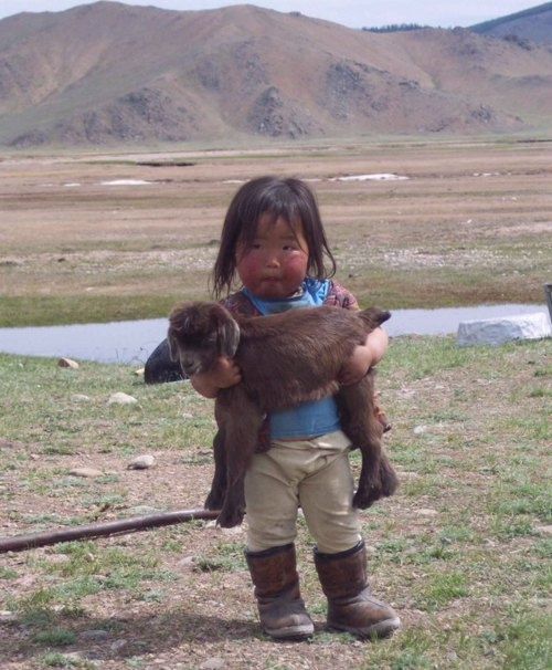 Mongolian childhood - rosy cheeks, baby goat as pet, and ugg boots.