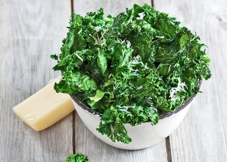 Olive oil, bold seasoning, and sea salt are all you need to turn fresh kale leaves into delicious good-for-you snacks