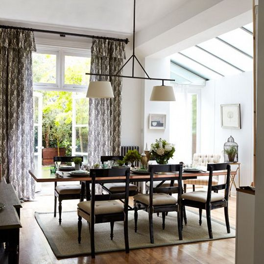 Classic Dining Room This Sleek And Inviting Layout Provides The Perfect Setting For Formal Patterned Curtains A Dark Pole Have Been Used