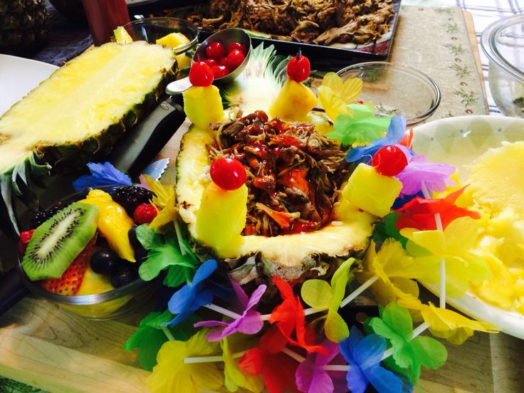 Maui Wowie sweet-and-sour pork served in a pineapple with festive luau lays