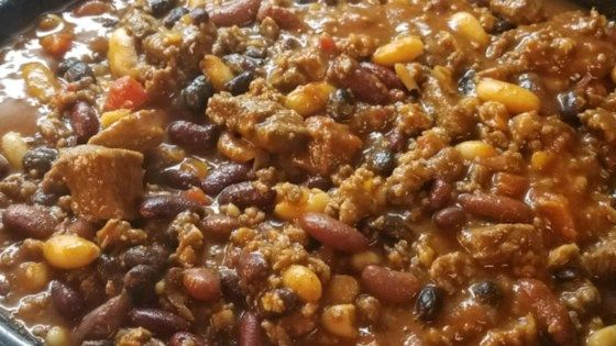 Venison, pork sausage, cannellini beans, and tomatoes combine in this lively chili seasoned with garlic, onion, and hot pepper sauce guaranteed to warm football fans.