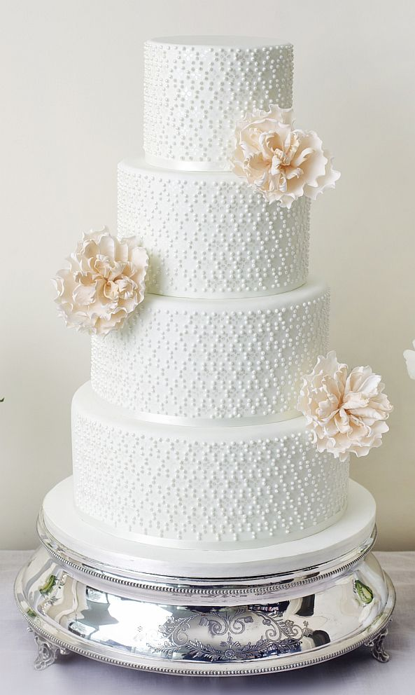 Elegant white dot detail with cream open peonies wedding cake