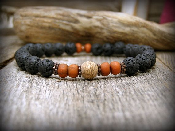 Black lava rock stone beads are combined with antique rust indonesian glass beads, matte picture jasper and copper spike heishi beads. These stones are 8mm in size.  Rustic and earthy....this bracelet could be worn with jeans or go a little more dressy with it, its that versatile. Wear alone, stack with other stretch bracelets or wear with your watch.  Size: Choose from the drop down menu above. ***** Please note....measure your wrist before ordering. See my policies for resizing fees…