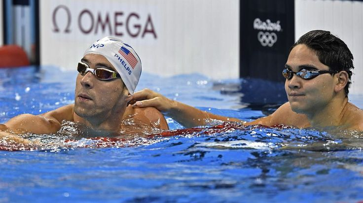United States' Michael Phelps silver medal and Singapore's Joseph Schooling Gold medal check their times after a men's 100-meter butterfly heat during the swimming competitions at the 2016 Summer Olympics, Thursday, Aug. 11, 2016, in Rio de Janeiro, Brazil.