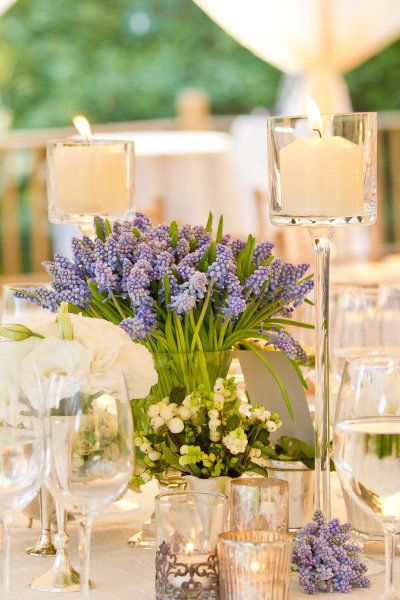 Love this!  Low flowers with tall candles