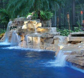This pool's faux rock waterfall offers the same look and feel as natural stone! RicoRock, Inc. http://www.poolspaoutdoor.com/outdoor-products/water-features-waterslides/articles/whimsical-waterfalls-fountains.aspx