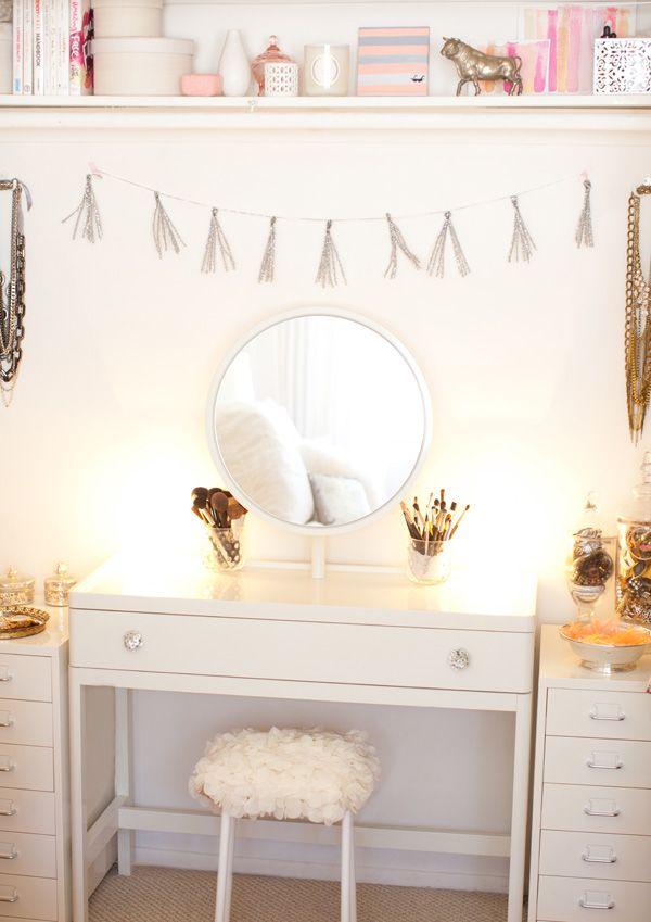 turn a desk into a vanity by adding a mirror above and two small side tables