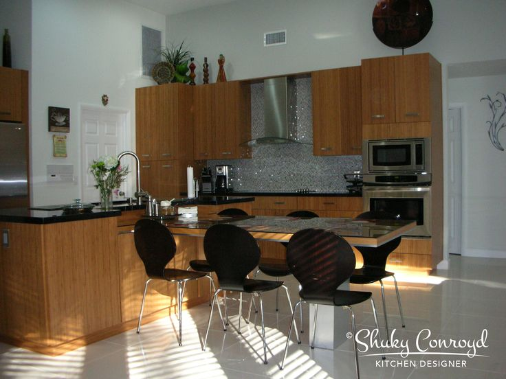 Contemporary kitchen design by Shuky Conroyd, Kitchen and Bath Designer. A full kitchen remodel. The natural Bamboo finish brings warmth to the space. The stone and glass backs plash adds the elegant touch and ties all the components of this kitchen together.