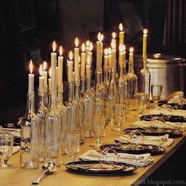 43 Cool Halloween Table Décor Ideas | Wine bottles as candelabras & hanging candles/bats garland over table