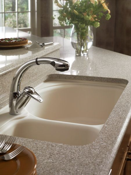 Detail Of Zodiaq® Countertop In Antique Pearl With A Corian® Undermount Sink