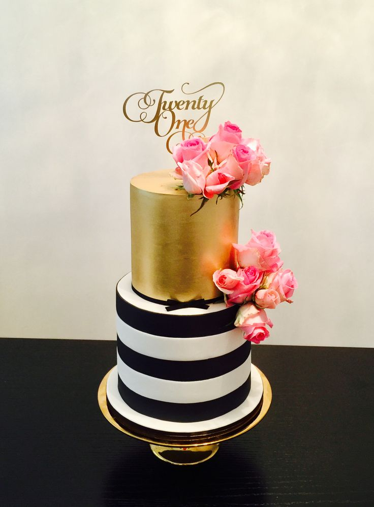 Black and white striped birthday cake with gold lustre