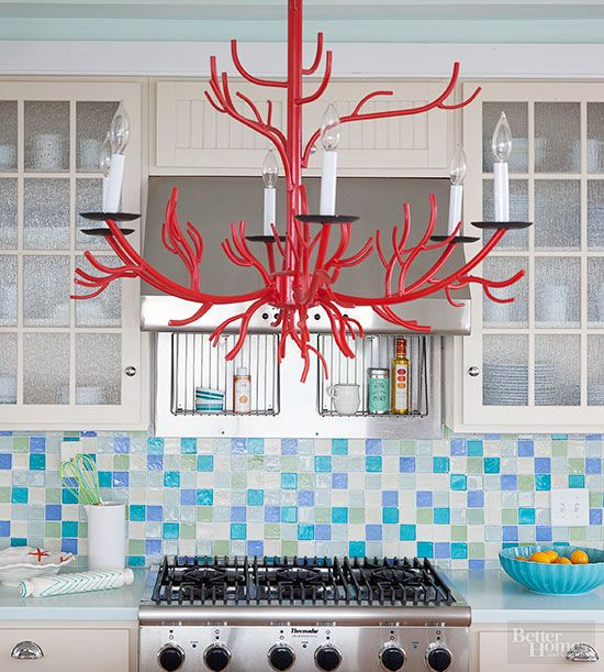 Get this great design look in your kitchen. Here, a shimmering array of neutrals, greens, and blues gives an organic feel thanks to the hand-finished look of the tile edges.