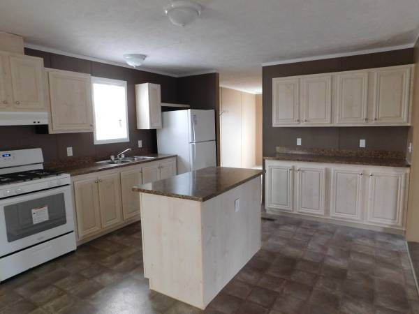 """$850*/3 Bedroom Home For Sale in Four Seasons.Call Mike Mayer at 309-673-5114. *Financing offered through First Choice MH LLC (""""First Choice""""), NMLS #1241272. First Choice is a Licensed Mortgage Originator in the State of Illinois. Monthly payment based on purchase price of $50,481 5% down payment, 8.5% APR, 20-Year Term. Payment includes estimate for taxes, title and insurance. All offers subject to credit approval by First Choice and approval through Four Leaf Properties for residency."""