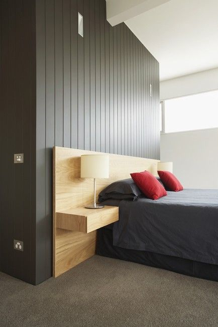 love the wood wall – would paint in grey, love the headboard – would pad the center and hang my lamps above.