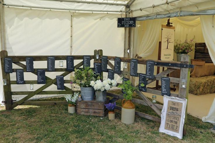 Rustic table plan, 5 bar gate and slate. Marquees are perfect for rural weddings.