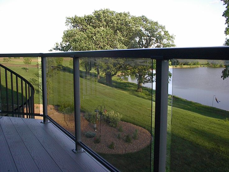 Deck Railing with Glass Panels See 100s of Deck Railing Ideas http://awoodrailing.com/2014/11/16/100s-of-deck-railing-ideas-designs/