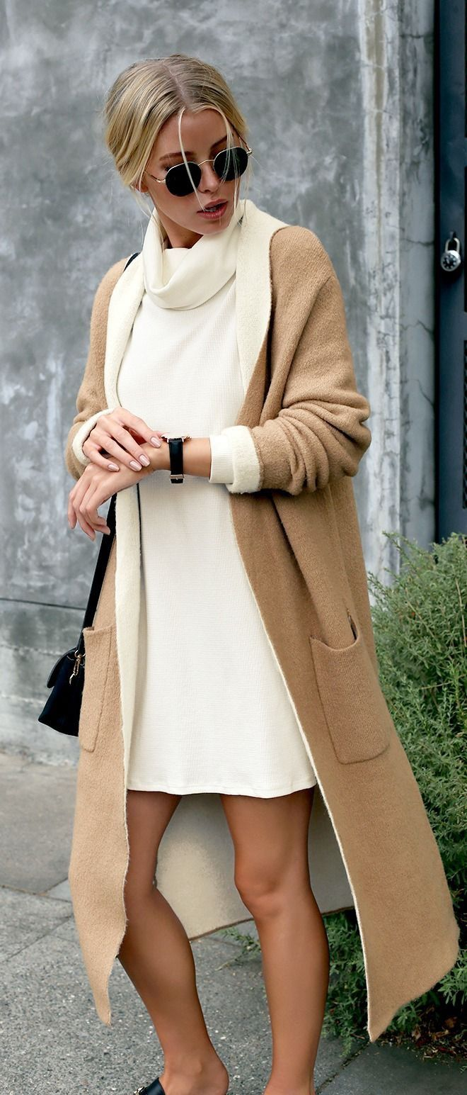 Love this cute white dress with a brown jacket