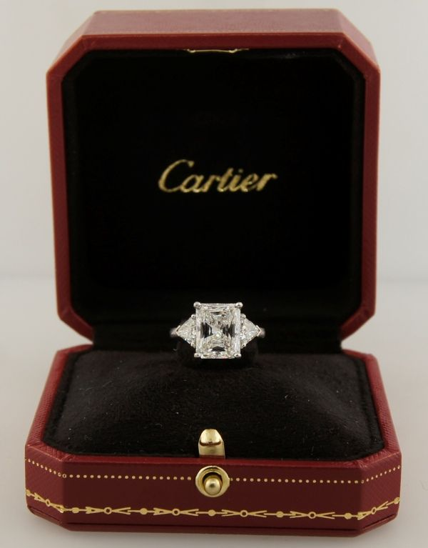 Cartier Diamond Platinum Three-Stone Ring GIA Certificate | From a unique collection of vintage engagement rings at https://www.1stdibs.com/jewelry/rings/engagement-rings/