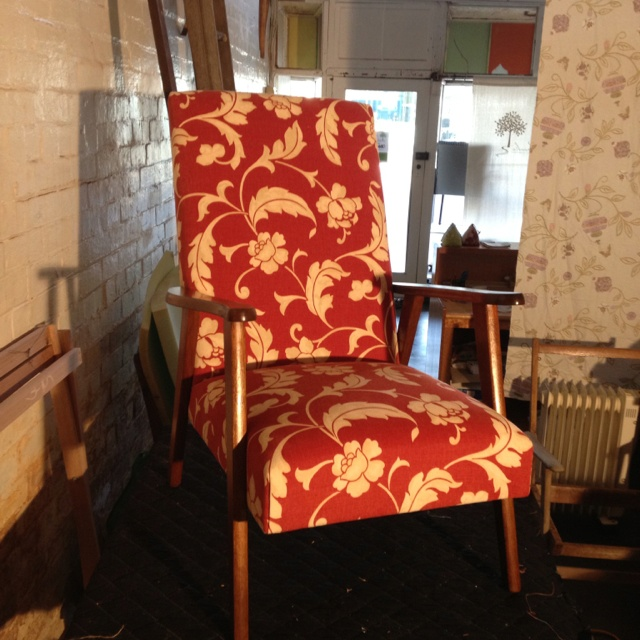 Restored a fire side chair reclaimed from the rubbish tip in a bright red floral.