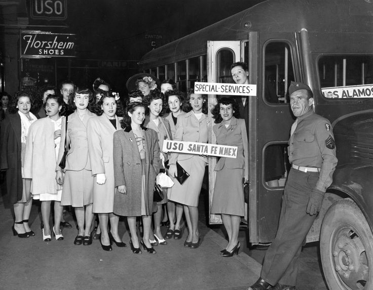 USO (United Service Organizations) members prepare to board a Los Alamos bound bus during WW II to entertain servicemen and scientists. Courtesy Los Alamos Historical Society Photo Archives (P1985-916-1-12141).
