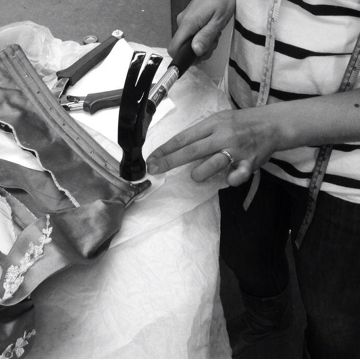 Gemma Sargent: Fashion Designer & Couturier - eyelet insertion for lace up back on bespoke silk corset