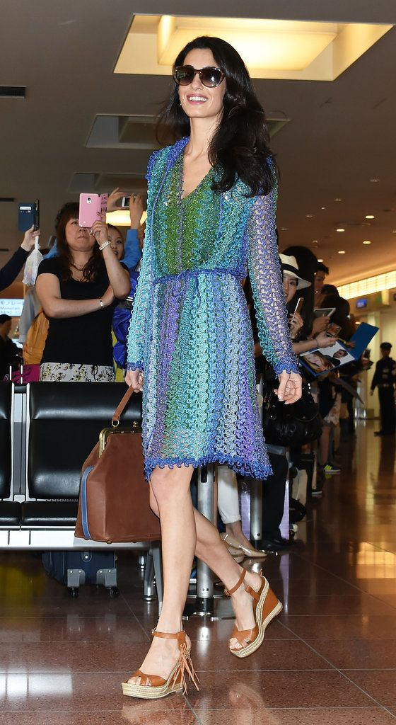 Amal Clooney showed off her stunning airport style when she arrived in Tokyo with George wearing a colorful sundress and wedges.