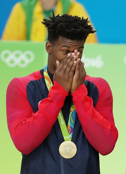 Gold medalist Jimmy Butler of United States reacts on the podium following the…