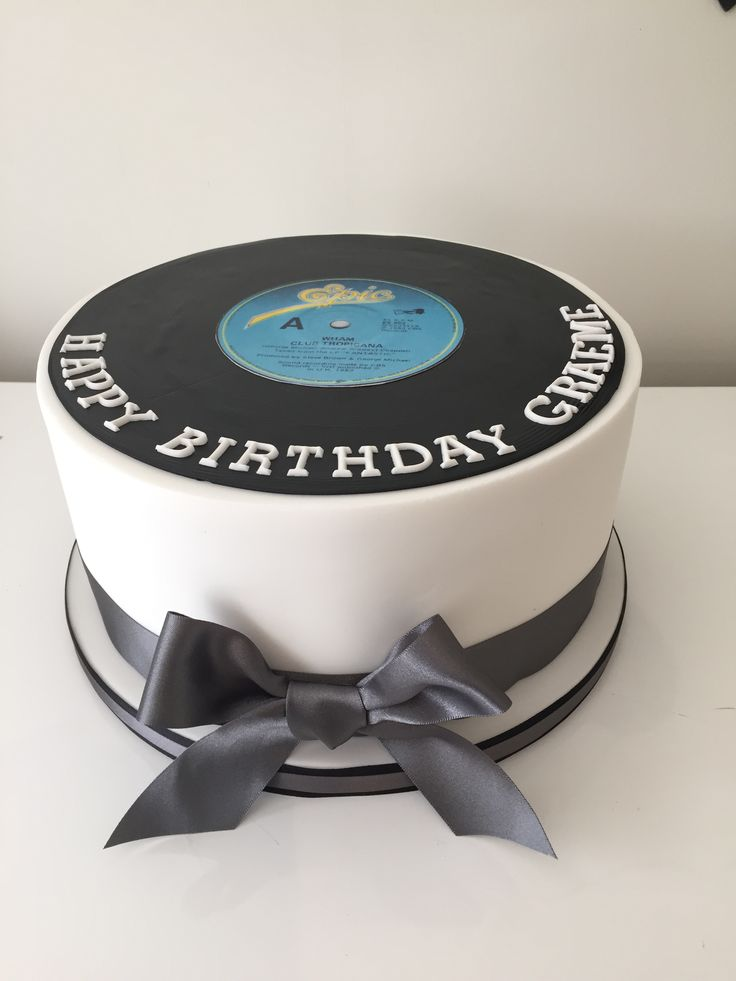 Record cake with edible print of the record the recipient made.
