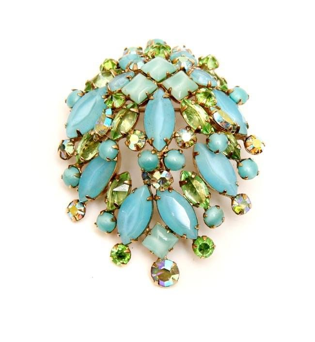 Fabulous 1950's Schreiner brooch.  For price inquiry e-mail us at…
