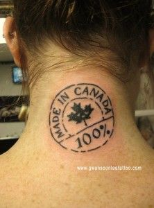 Made In Canada Stamp Tattoo behind Neck