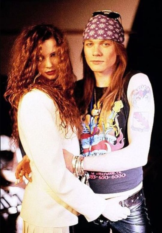 "Axl Rose of Guns N' Roses with then girlfriend Erin Everly, during the making of ""Sweet child o' mine"""