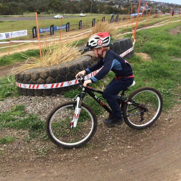 Nels taking his 510MTB Kids Mountain Bike onto the official circuit after the kids race.