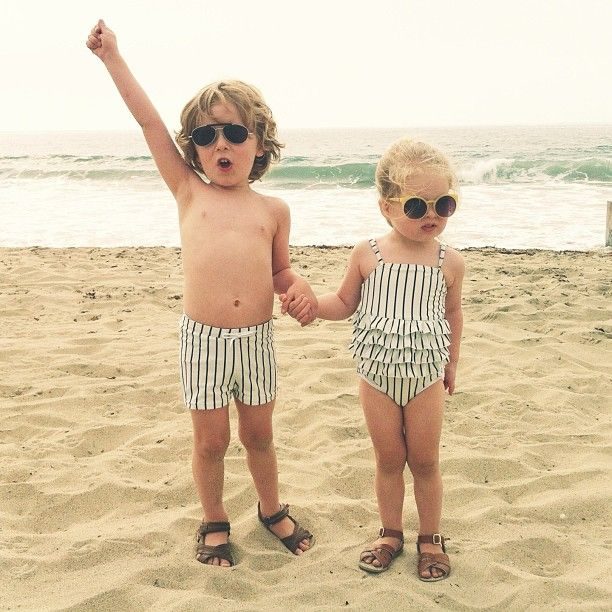 Vintage, nautical inspired matching boy girl kids swimsuits. Mini Rodini Striped ruffle swimsuit and swim shorts. Photo from @theselovelysibs on instagram.