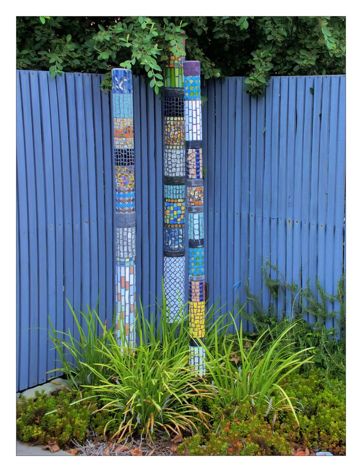 """Spotted this """"artwork"""" in someone's garden. Based on Aboriginal style """"totem poles"""" or didgeridoos ... though these are done in mosaic tiles, clever and unique installation IMO, and btw, the whole ..."""