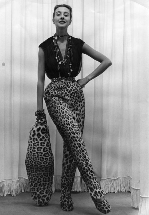 Pierre Balmain leopard designs, 1951. I am surprised the shoes are not high heels. Interesting the way the trousers are made to cover the shoe tops.