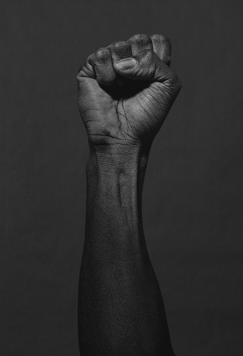 The raised fist (also known as the clenched fist) is a symbol of solidarity and support. It is also used as a salute to express unity, strength, defiance, or resistance. The salute dates back to ancient Assyria as a symbol of resistance in the face of violence. The Black fist, aka the Moor Power fist, is a logo generally associated with Moor Strength, Moor Unity, Moor Nationalism and Moor Socialism. Its most widely-known usage is by the Black Panther Party in the 1960s and now it's back.