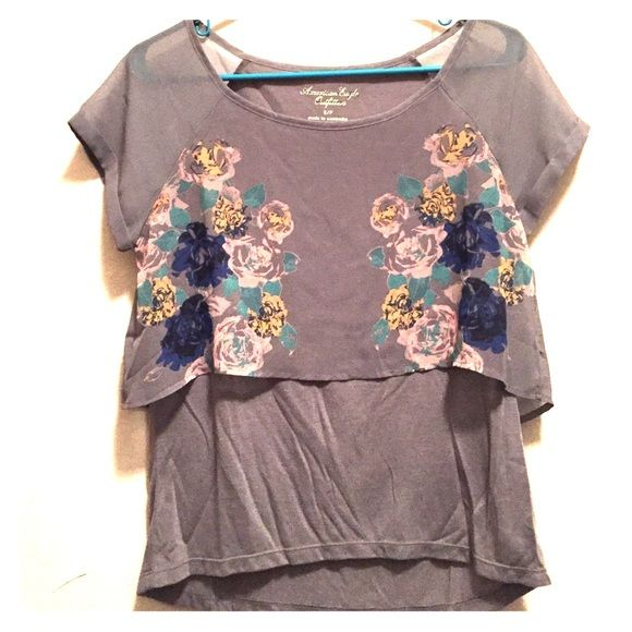 Floral American Eagle top Flowy grey American Eagle with pretty floral detail. Purchased at an outlet so the label is crossed out, but is AE. Barely worn, great shape! American Eagle Outfitters Tops Blouses