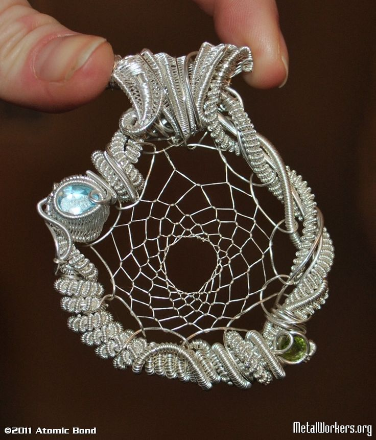 """This wire sculpted jewelry was made by Cody Cantrall of """"Wraps by Cody."""" I got to meet him at a gem show in Tucson, Arizona. If you would like a custom necklace, email him at codycantrall@yahoo.com He is going to make me one custom with mystic fire topaz."""
