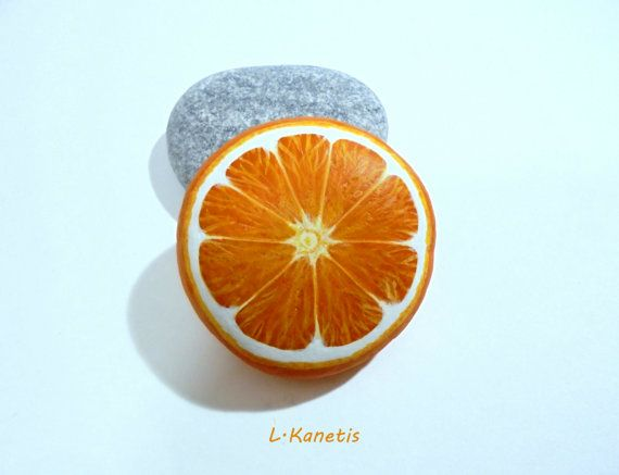Hand painted stone round orange slice Is painted by KanetisStones