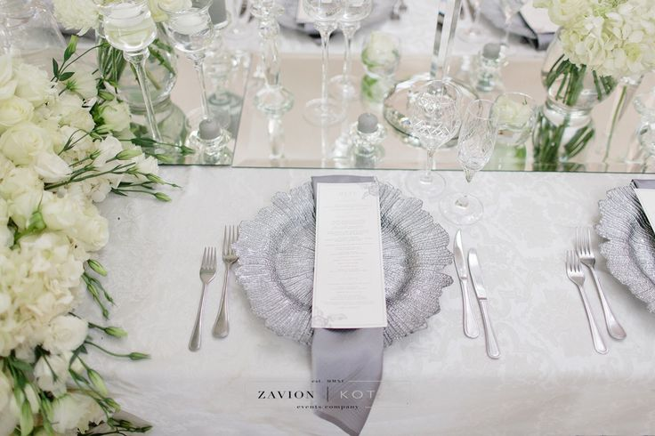 Crisp white flowers, softened by champagne table cloths and soft candle light. Floral runner with orchids and white roses. Luxe Wedding, Royal Wedding, Orchids, mass arrangements, large wedding flowers, luxury wedding Photographer Rensche Mari