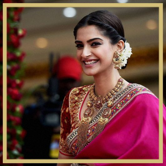 Sonam opted for a custom Abu Jani Sandeep Khosla saree in south Indian silk with motifs making up a wedding procession, embroidered with zardozi and multi-hued resham. Styled by Rhea Kapoor, Sonam set some really high standards for every Indian bride-to-be.