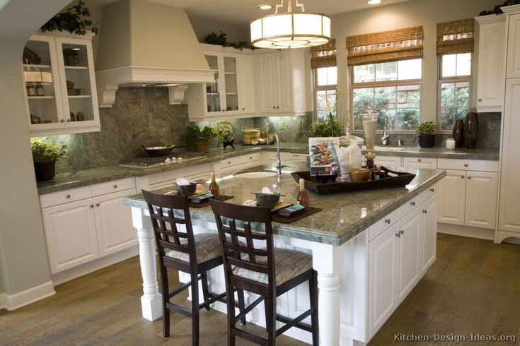 Kitchen of the Day: Traditional white cabinets pair nicely with wood floors and light green Costa Esmeralda granite countertops.... Picture #59 in Traditional White Kitchens