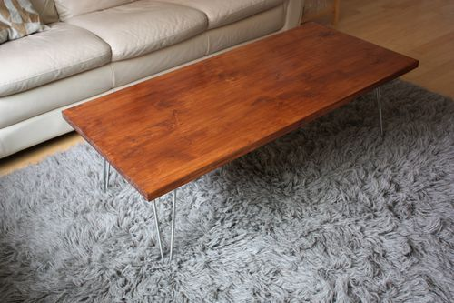 """DIY mid century modern coffee table. wood is a 1"""", $35 piece of white pine with a stain, plus hairpin legs from hairpinlegs.com (which apparently is a real thing )"""