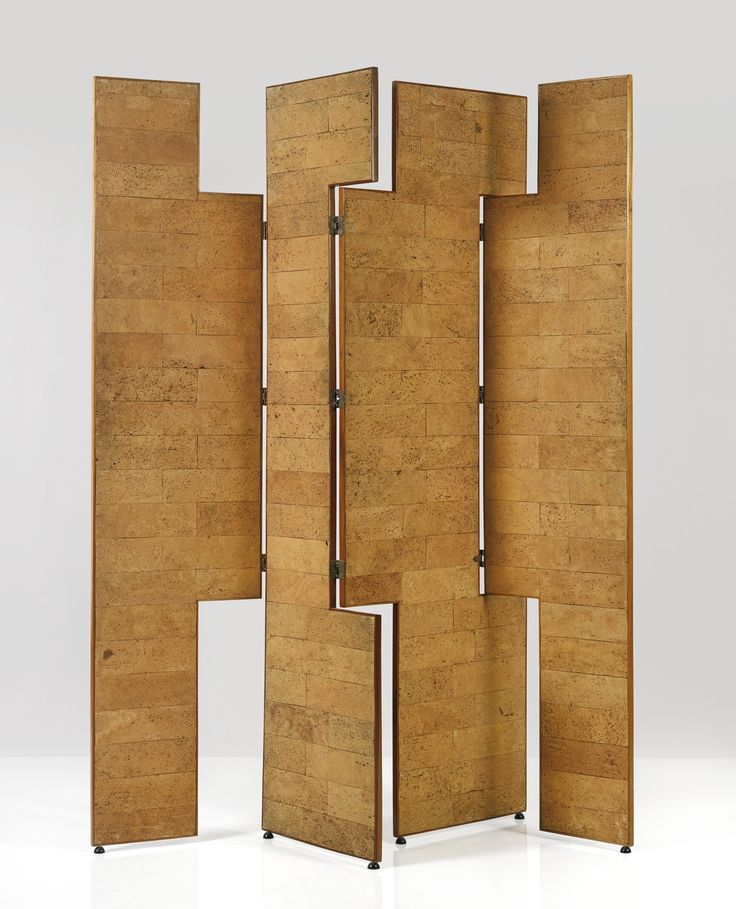 EILEEN GRAY AN IMPORTANT FOUR-PANEL SCREEN each foot marked ARMSTRONG CORK COMPANY LTD LONDON cork and blond mahogany each panel:  83 5/8  x 27 1/2  in. (212.4 x 69.9 cm) designed circa 1960 edited and executed in 1973  from an edition of 5 executed by Pegram, Royal College Street, London edited by Prunella Clough