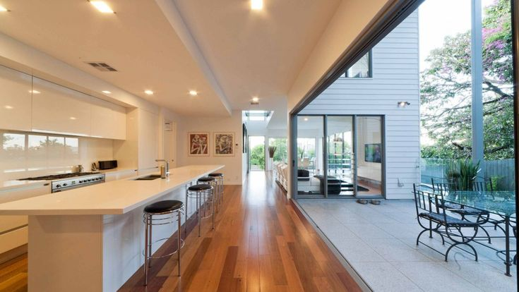 Incredible bifolding doors fully open the kitchen to the outdoors. Modern Australian home