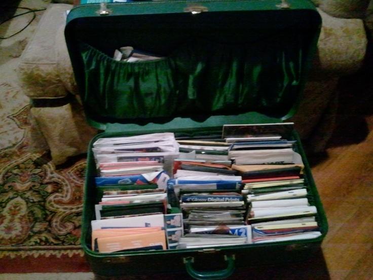 cute idea, vintage suitcase! Photo Storage