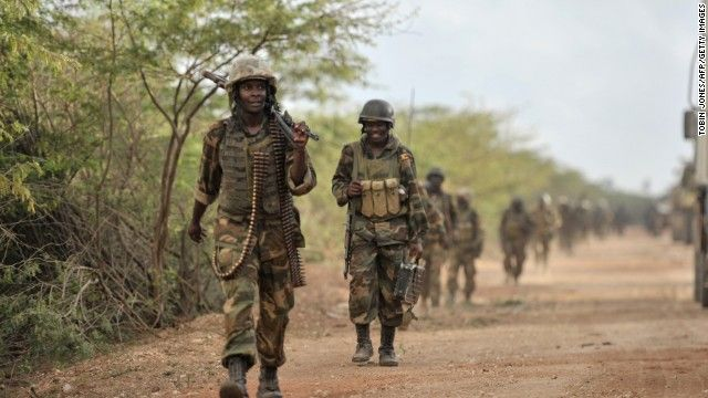 This handout picture released by the African Union-United Nations Information Support Team on August 30, 2014 shows Ugandan soldiers, part of the African Union Mission in Somalia, marching towards the town of Golweyn in Somalia's Lower Shabelle region on August 30, 2014, controlled by Shebab fighters. African Union forces claimed to have liberated a former Shebab stronghold in Somalia on August 30, 2014 as part of a joint offensive with government troops aimed at capturing key ports from...