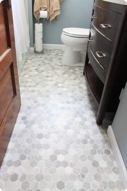 hexagon vinyl floor: I've seen this stuff in the stores...it's an amazing low cost solution and looks fantastic.